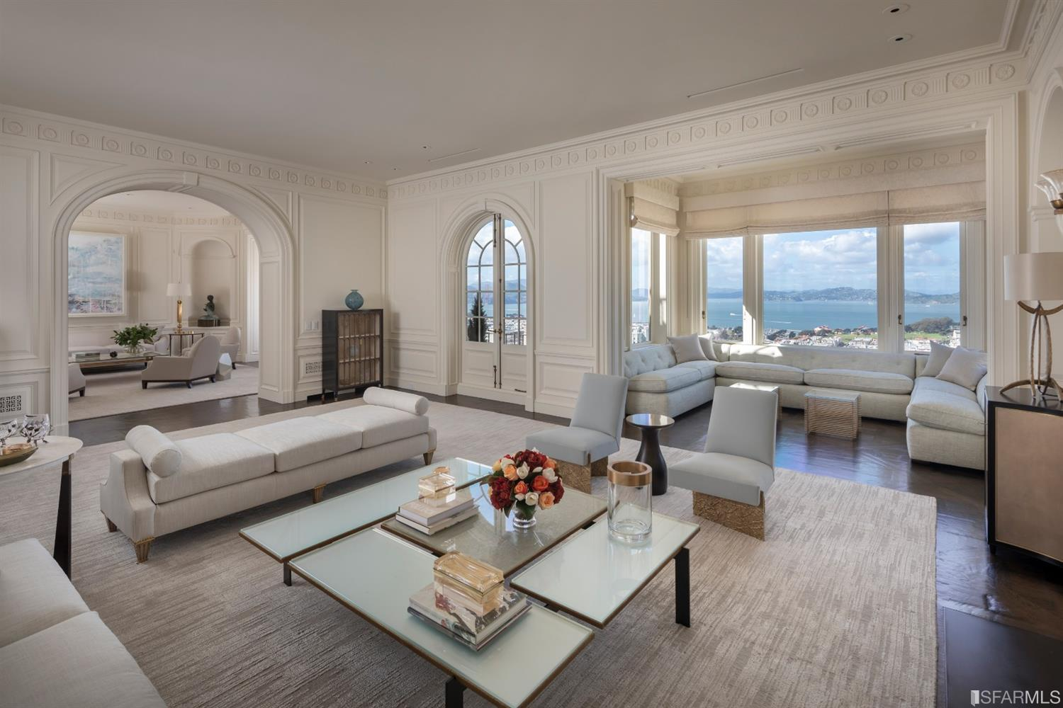 This 2 level beautifully renovated Penthouse at the esteemed 2000 Washington Street showcases sweeping views from the Golden Gate Bridge to Russian Hill. Sophistication is found at every moment, from the prominent entry hall with sweeping stair and fireplace, to the nearly 50' long grand gallery framing Bay views. The large public rooms with panoramic views set the tone for entertaining. An upper level library/media room opens to a full-width rooftop terrace with spectacular views of the GGB & Alcatraz.