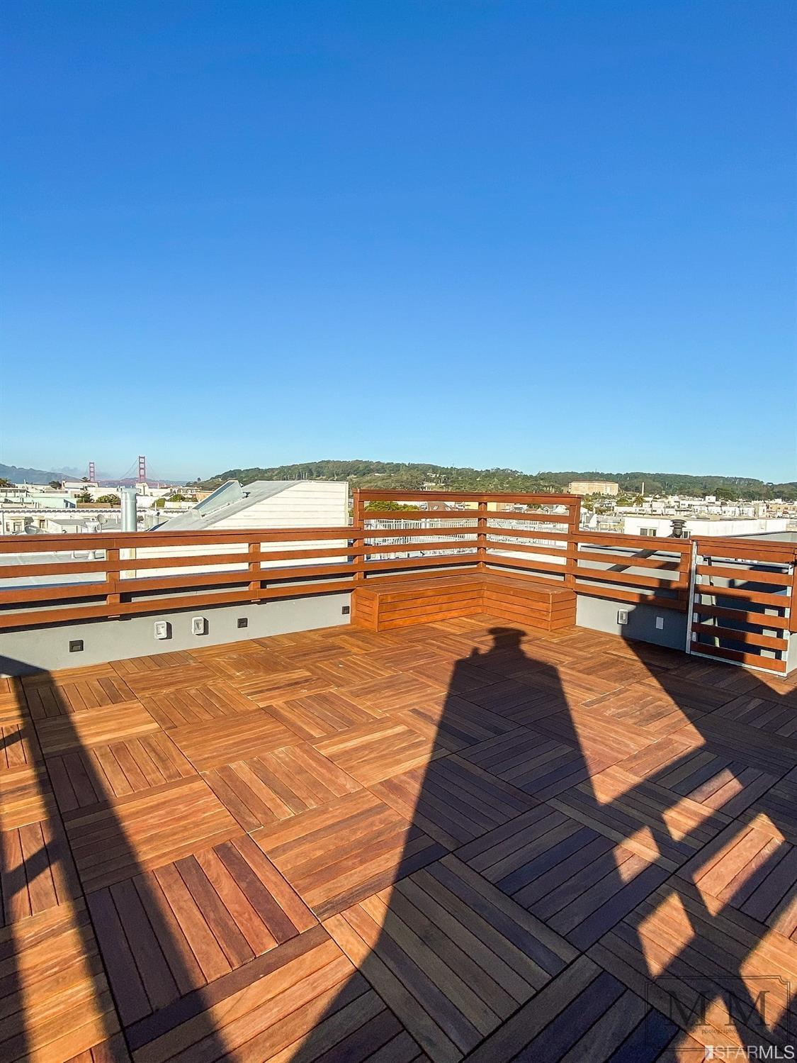 This stunning penthouse residence is truly a gem. A stunning glass retractable skylight rooftop opens to a spacious roof deck with hardwood decking and custom benches that boasts expansive views encompassing the Presidio, Golden Gate Bridge and Downtown San Francisco.  The 3 bed/2.5 bath residence includes luxurious features selected by a team of architects and interior designers. The unit is outfitted with white oak hardwood flooring, floor-to-ceiling windows in the living and dining rooms, a fireplace, CAT6 wirings, Nest thermostat, and dimming LED recessed lightings.  Owners will enjoy a level of finishes in this one-of-a-kind home including a Chefs' kitchen island that is made of two large slabs of marble, top-of-the line appliances and wine cooler, and custom  kitchen cabinetry. The master suite features a walk-in closet and an adjoining hardwood deck balcony. Revel in an elegant master bathroom, custom marble mosaic flooring, a freestanding tub, and a extra-long sink for two.