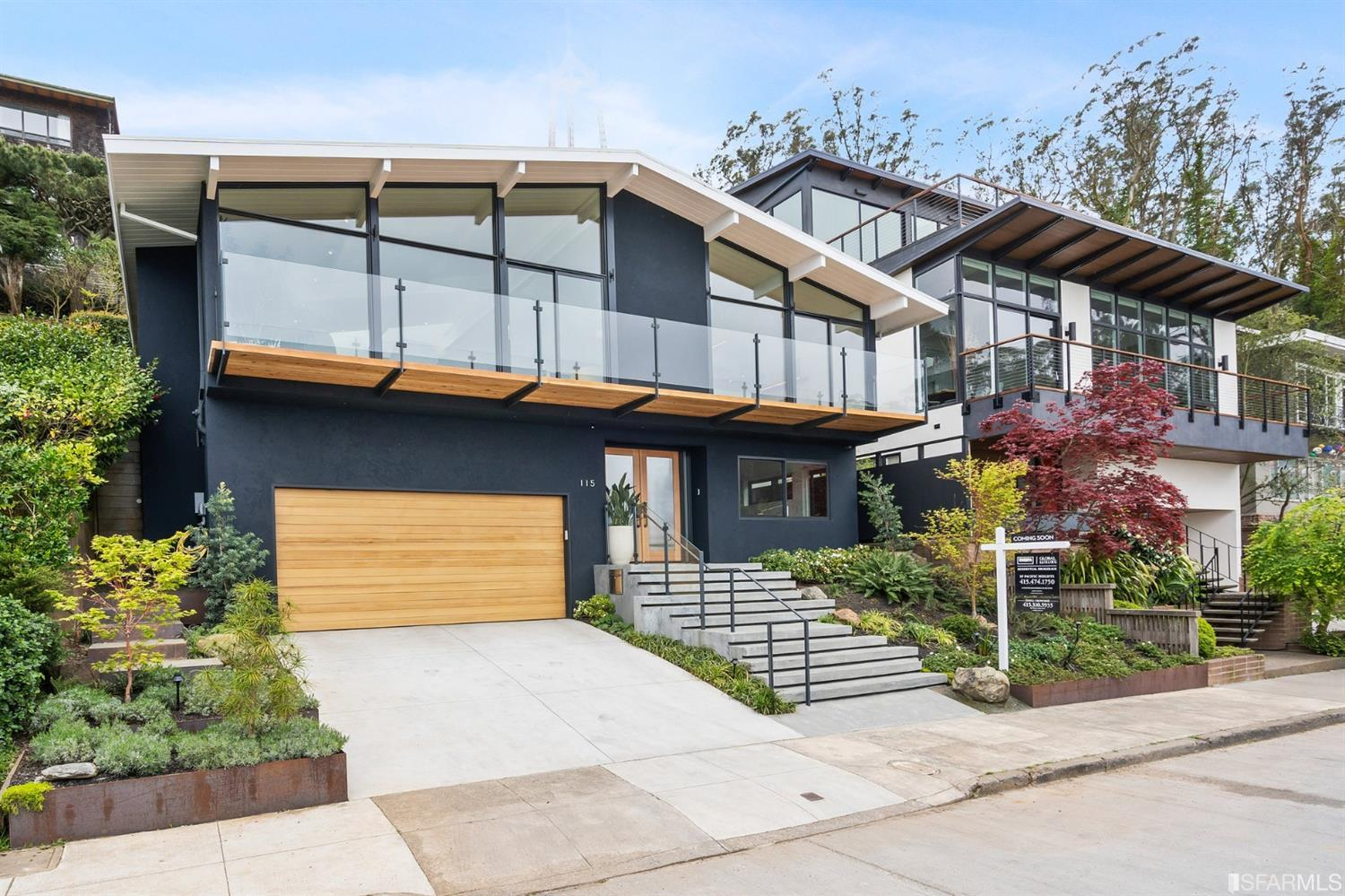 Modern 3BR/3.5BA detached, extensively renovated residence enjoys sweeping views, across the full width of the home, from the Golden Gate to downtown and beyond. A spacious and light great room with vaulted ceilings and skylights accesses the cantilevered front deck thru floor-to-ceiling tall sliding glass doors. Features include entertainment center, woodburning fireplace + gas starter, built-ins, hardwood floors. Gourmet kitchen includes Miele appliances, butler's pantry, long work island. Up a split level is the powder room and two suites, one with walk-in closet. Each bedroom opens to the landscaped rear patios, gardens, terraced outdoor entertainment and viewing platforms. See Napa on a clear day? Entry foyer, guest quarters/home office suite with views and laundry on the lower level. Interior access double garage. Smarthome systems, Lutron & A/V. Prewired for solar. Ideally situated on the serene city-facing eastern slope of Twin Peaks adjacent open space hiking & biking trails.