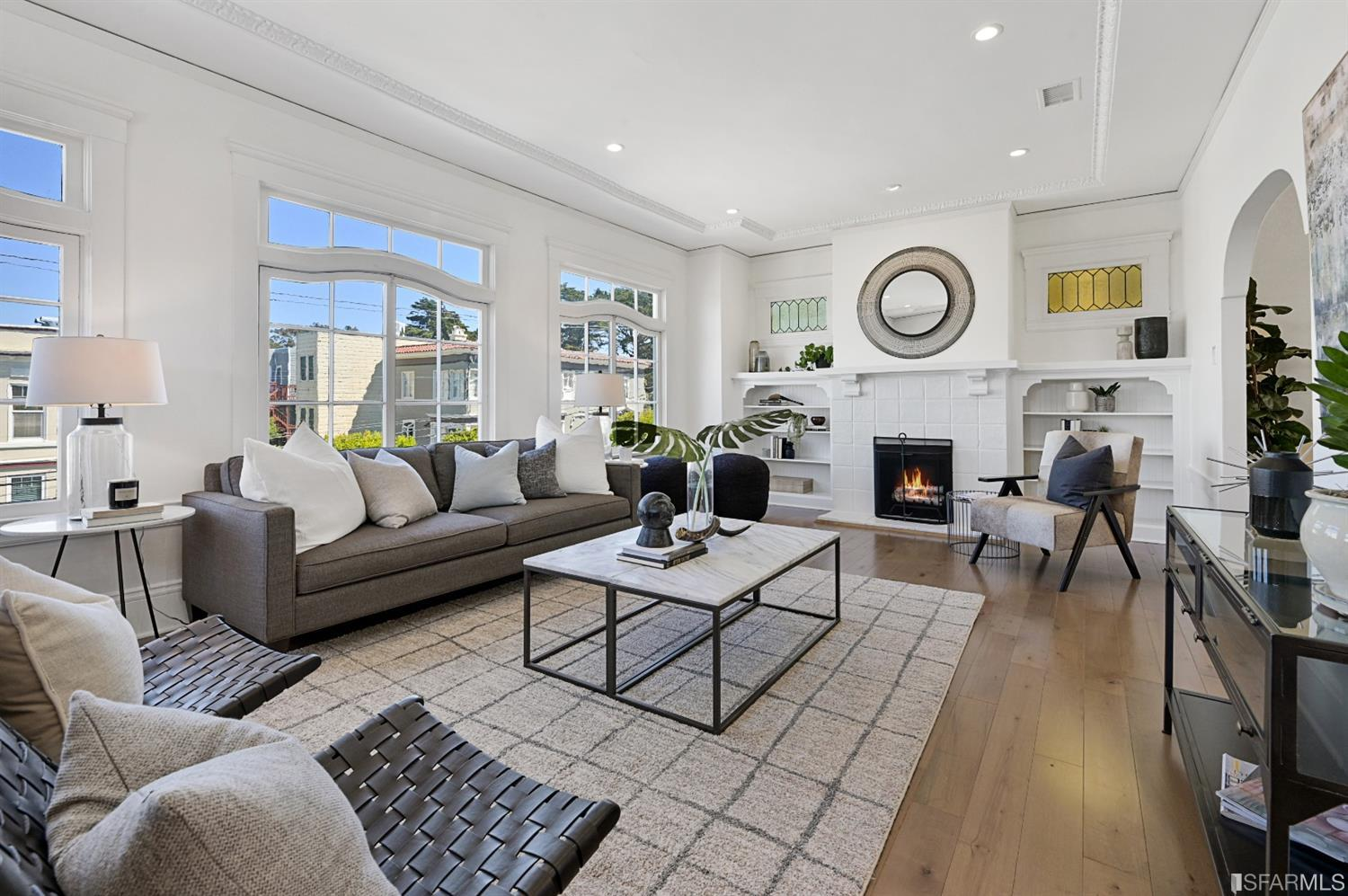 Located in the tranquil Richmond District, this bright, top-floor condo in two unit building offering 2 bedroom, sunroom, and 1.5 baths with expansive living and dining rooms throughout. Impeccable flow, wide-plank wood, generous foyer, living room with immense windows Craftsman-style fireplace, flanked leaded glass accent windows and built-in shelving. Wainscoting, period details and ornamental moldings embrace this space. Arched doorways lead to large formal dining area. Remodeled chef's kitchen with eat in area, stone countertops, stainless-steel appliances, washer/dryer closet are rigorously functional, Two bedrooms, each quite generously proportioned, with custom closet systems, offer access to a third light-filled sun room. Two bathrooms, including a powder room and a full bath. ADDITIONAL 200 square foot multi-purpose room off the garage, one car independent parking, shared spacious backyard deck and patio. Perfect central location, this condo has it all.